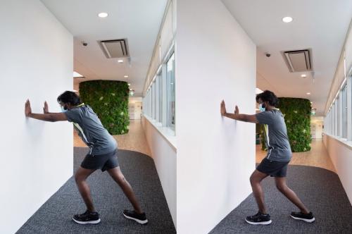man-doing-calf-stretch-and-achilles-stretch
